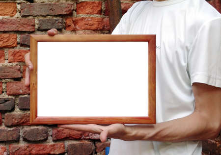 Man in white t-shirt demonstrating your text or picture photo