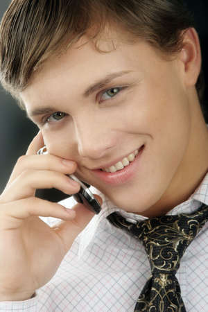 Very young and very attractive  businessman  with phone Stock Photo - 836458