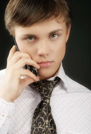 Young businessman with mobile phone , looking tired Stock Photo - 838940