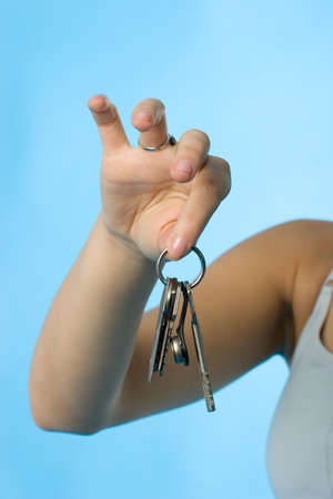 Beautiful womans hand demonstrating the bunch of keys Stock Photo - 1657762