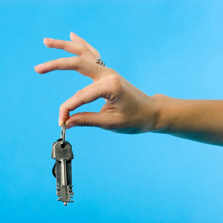 Beautiful womens hand demonstrating the bunch of keys Stock Photo - 1657780