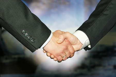 Business handshake over abstract blue background  photo