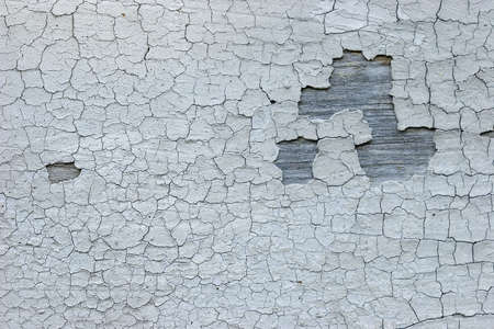The old cracked faded paint on a wooden background photo