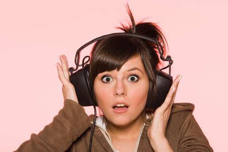 Surprised girl with headphones photo