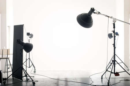 Photo of an empty photographic studio with modern lighting equipment. Empty space for your text or objects. photo