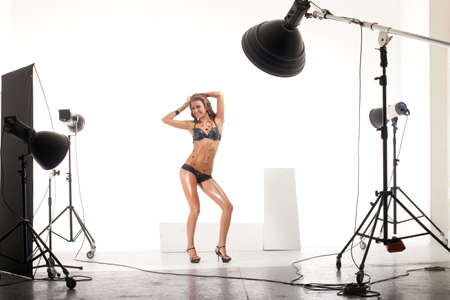 reflectors: Young and sexy model posing in professionally equipped studio