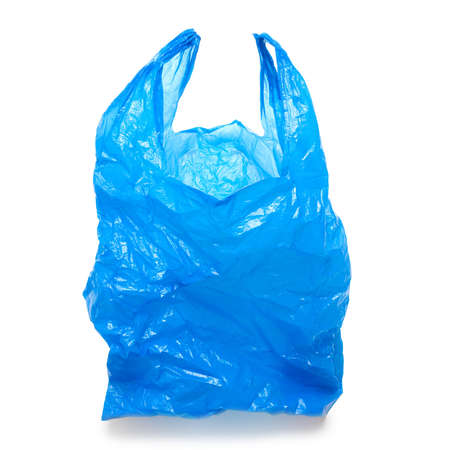 Blue empty plastic bag isolated over white background photo