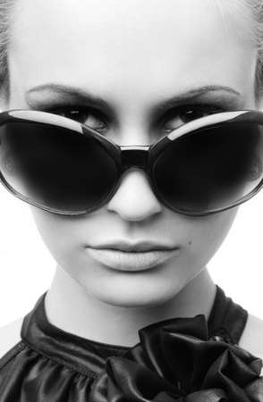 Woman in sun glasses. Fashion portrait photo