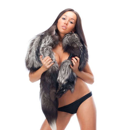 Attractive young brunette woman wearing a black furs and black panties Stock Photo