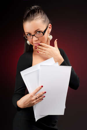 Young and sexy businesswoman with some documents in her hands Stock Photo - 5765962