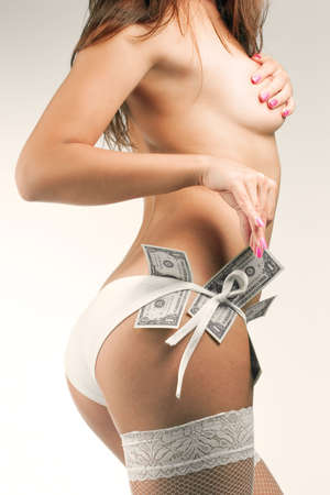 Sexy female body with dollars in panties photo