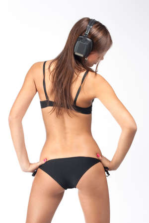 Sexy girl in black bikini listening her faforite music photo