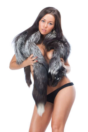 Attractive young brunette woman wearing a black furs and black panties Stock Photo - 5787913