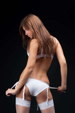 Beautiful young woman in white lingerie