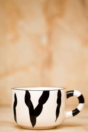 Big tea cup with zebra stripes photo