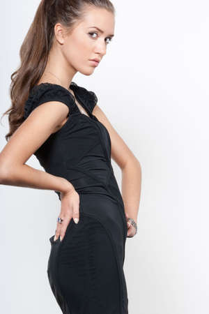 Fashion model in little black dress photo