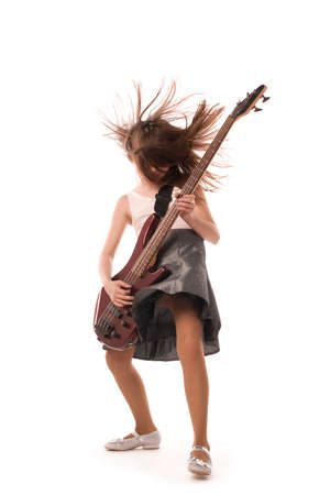 Young girl playing hard on an electric guitar photo