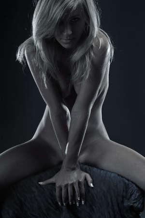 Naked blonde woman posing over dark background Stock Photo - 6550400