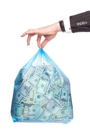 Man hand holding a plastick bag full of money photo