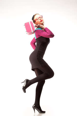 Stylish bizzare woman posing in retro dress with pink purse in her hands. Isolated over white background. photo