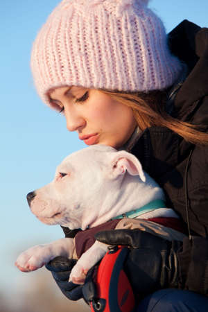 Girl with her white little dog Stock Photo