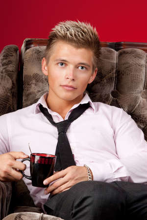 Young business man with cup of coffee photo