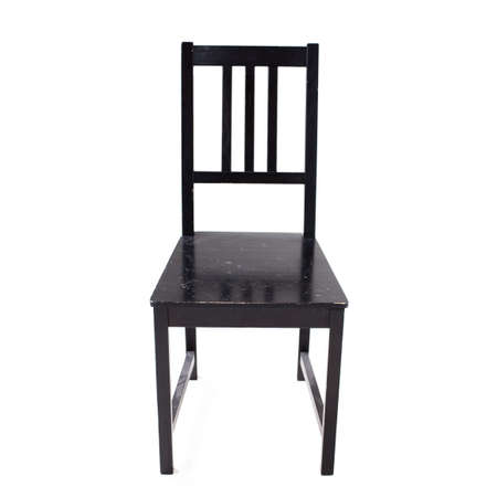 Old black painted wooden chair. Isolated over white background