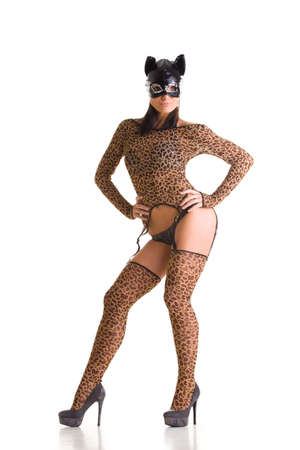 Sexy go go dancer wearing catwoman costume and mask Stock Photo - 7657619