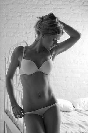 Sensual woman in white lingerie. Monochrome image.
