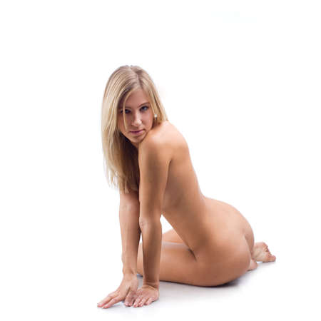 Naked girl with blond hair sitting on white background