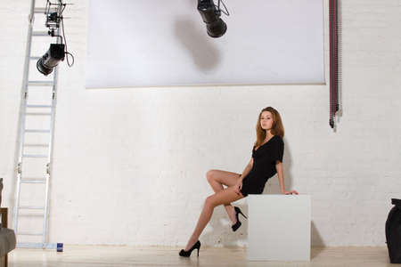 Fashion model posing in professionally equipped studio