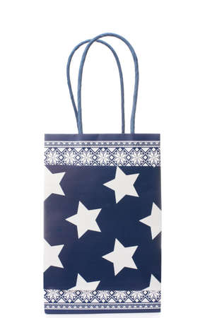Blue paper gift bag with stars. Isolated over white background.  photo