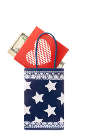 Paper gift bag with greeting card and money  . Isolated over white background photo