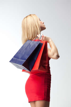 Young stylish blonde woman with shopping bags. Isolated over white background Stock Photo - 8446069