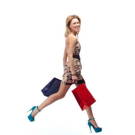 Running woman with shopping bags. Slight Motion Blur   photo