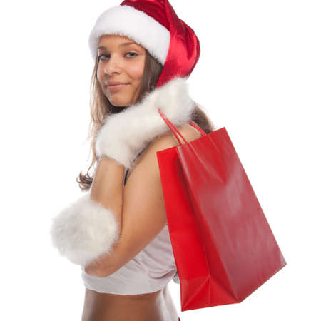 Beautiful sexy girl wearing santa claus clothes with paper gift bags in hands Stock Photo - 8446062