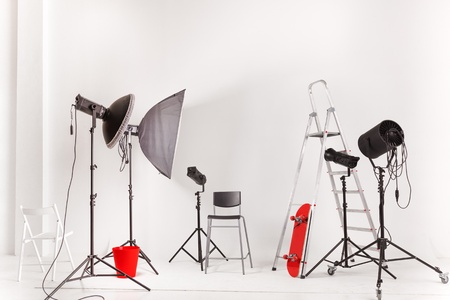 Empty photographic studio with modern lighting equipment photo