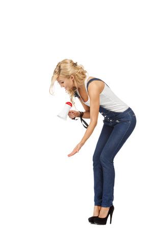 dominacion: Mujer rubia grita a alguien pequeño concepto Domination Foto de archivo
