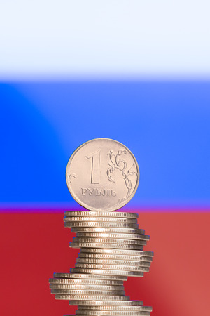 ruble: Unstable column of rubles against the Russian flag