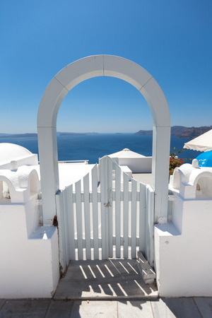 aegean sea: White arched gateway above aegean sea in Oia, Santorini, Cyclades, Greece Stock Photo