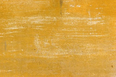 uneven edge: Old yellow cracked abstract grunge background.  Find more in my portfolio