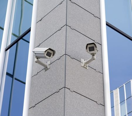 Two security cameras attached on building corner Stock Photo - 799014