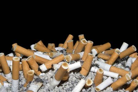Cigarettes in ashtray isolated on black background photo