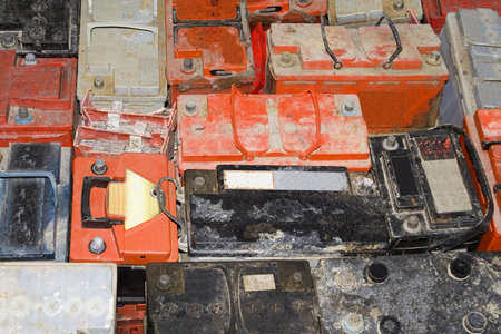 amperage: Background of old empty car battery