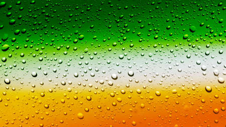 Irish flag on glass of beer with bubbles photo