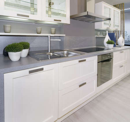 Full frame of simple white modern kitchen Stock Photo