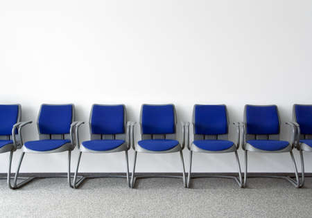 chairs: Blue chairs in ordinary empty waiting room