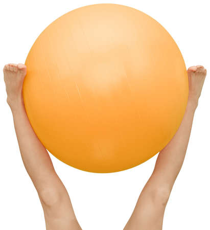 with orange and white body: Exercise with pilates ball