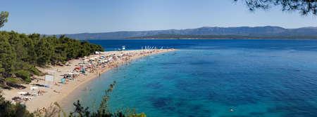 Golden Cape, Zlatni rat beach, Bol town, Island Brač (Brac), Croatia - June 25, 2011: Beginning of vacation season at summer solstice on famous Croatian touristic destination.