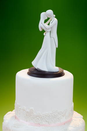 Figurines on Top of Wedding Cake photo